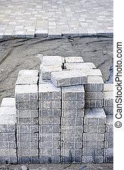 Interlocking stone driveway - Stacks of interlocking stones...