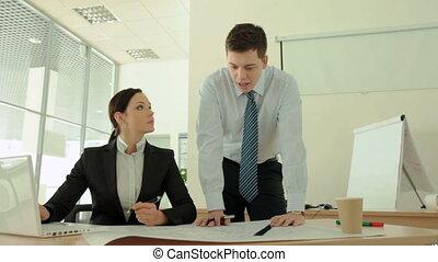 Intern blueprint - Lovely female supervisor correcting...