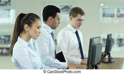 Intern Team - Confident supervisor interacting with his team...