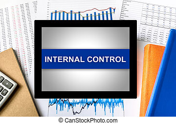 internal control word on tablet with financial graph...