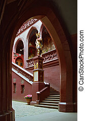 Internal red yard with sculpture and steps in Rathaus in Basel Swtizerlandc