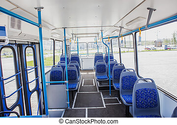 Internal view of an empty bus in the street of a city.