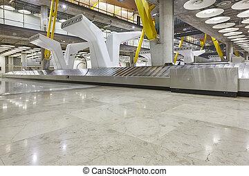 International airport baggage belt claim area. Nobody. Travel background.