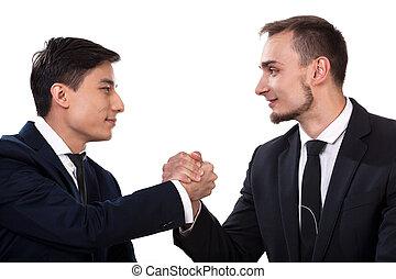 International business partners during handshake