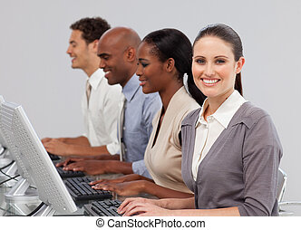 International business people in a line working at computers