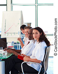 International business people in a presentation looking at...