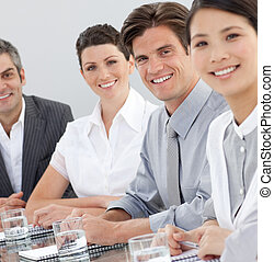 International business people sitting around a conference table