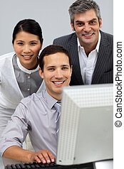 International business people working together at a computer