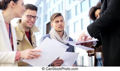 international business team with papers outdoors