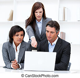 International business team working at a computer
