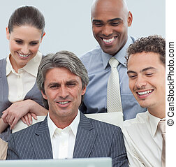 International business team working at a laptop