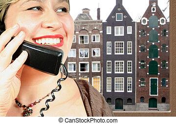 International call - woman makes an international phone call...