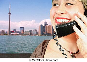 International call - woman makes an international call in ...