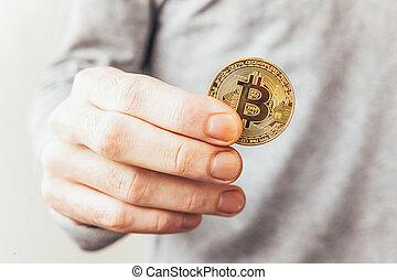 international, cryptocurrency, payment., crypto, électronique, homme, main, banque, réseau, toile, doré, virtuel, currency., symbole, concept., bitcoin, exploitation minière, tenue, coin., argent