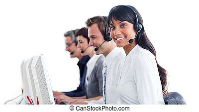International customer service representatives with headset on in a call center