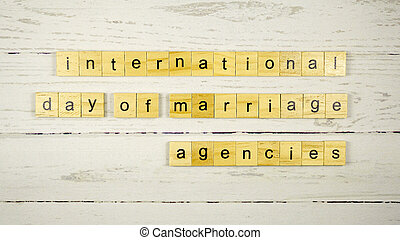 International Day of Marriage Agencies.words from wooden cubes with letters