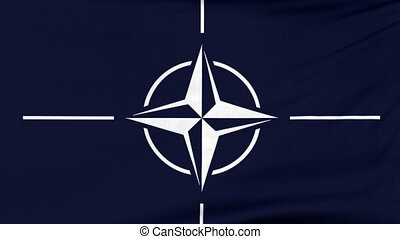 International flag of NATO flying on the wind -...