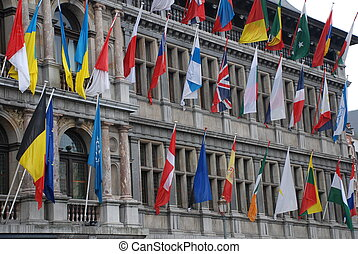 A lot of international flags on a historical building in Antwerp, Belgium