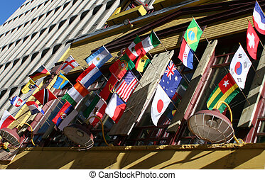 international flags - flags from around the globe in front ...