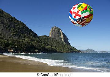International football soccer ball floats above Sugarloaf...