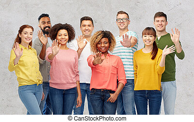 international group of happy people waving hand