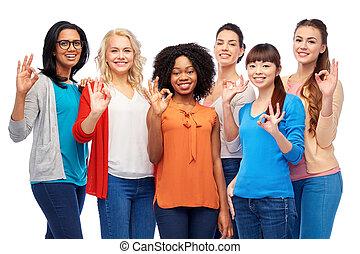 international group of happy women showing ok