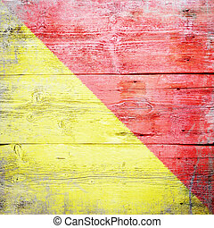 Oscar, international maritime signal flag painted on grungy wood plank background