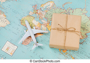International shipping. White model airplane land on the geographical map background