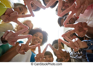 international students showing peace or v sign