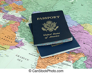 international travel - 2 passports on world map