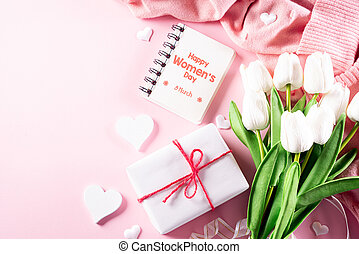 International Women's Day concept. Woman lace lingerie jewelry perfume present with white tulips on bright pink pastel background. flat lay, March 8.