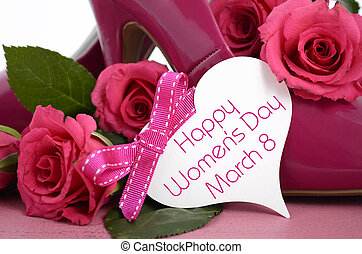 International Womens Day, March 8, ladies pink high heel stiletto shoes and roses on vintage pink wood background, with greeting card, closeup.