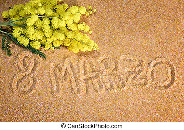 mimosa on sand with 8 marzo written