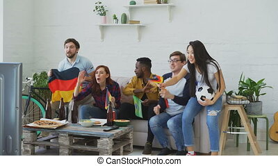 International young friends watching olympic games match on...
