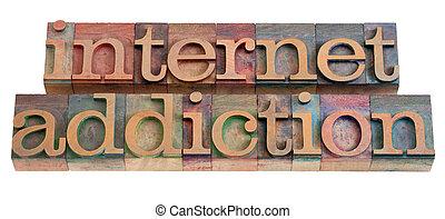 internet addiction phrase in vintage wooden letterpress...
