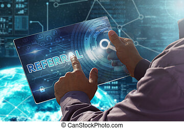 Internet. Business. Technology concept.Businessman presses a button Referral on the virtual screen tablet future date.