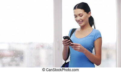 internet, communication and technology concept - woman with cell phone sending text message