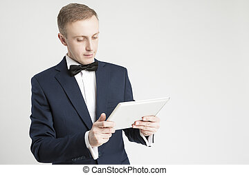 Internet Concept. Portrait of Young Handsome Caucasian Man Using Digital Pad for Communication.
