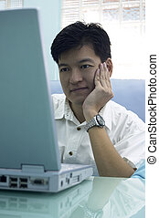 Internet Dating - A man surfing on the internet & ...