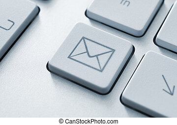 Internet email communication concept with a button on computer keyboard