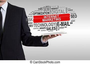Internet Marketing concept. Man holding a tablet computer