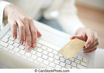 Internet purchase - Female hands with credit card during...