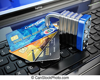 Internet security concept. Credit cards and lock on laptop keyboard.