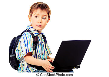 internet - Shot of a boy with his laptop. Isolated over...