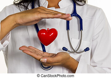 internist with heart - a young doctor (internist) holds a...