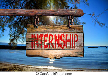 Internship motivational phrase sign on old wood with blurred background