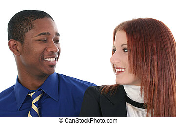 Smiling interracial couple over white background.