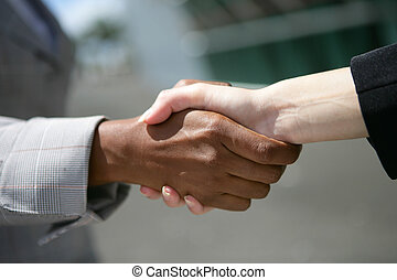 Interracial business hand-shake
