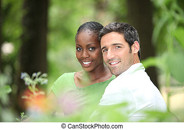 Interracial couple in a park.