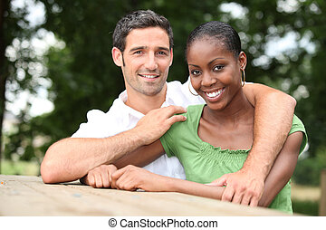 interracial couple in the park